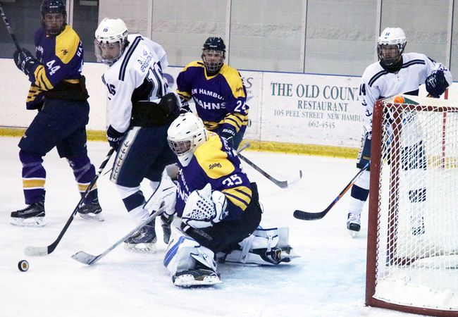 Woodstock Navy Vets Austin Sine, left, looks to knock in a rebound past New Hamburg Firebirds goalie Michael Black in New Hamburg, Ont. on Friday November 17, 2017. The Vets won their weekend games to move into first place. Scott Knox/Special to the Sentinel-Review