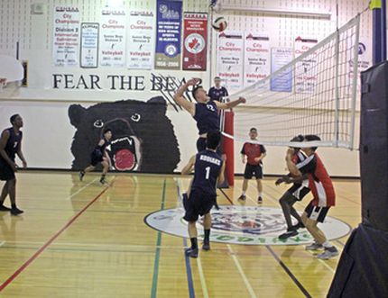 The St. Martin de Porres Kodiaks (dark blue) senior boys' volleyball team hosted Forest Lawn in the Calgary High School Sports Athletic Association quarter-finals and won 3-0 on Nov. 14. The Kodiaks then beat Bowness in the semi's to qualify for provincials and topped that off with a city championship with a 3-2 win over Father Lacombe in the finals.