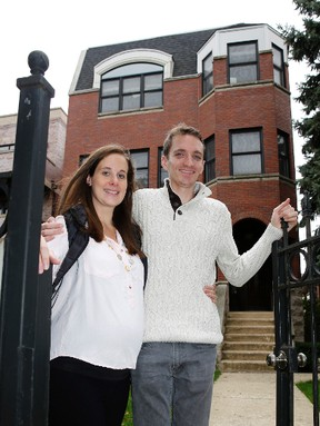 Emily and Brian Townsend, who own the top floor unit of a building in Chicago, were surprised by the hidden costs. (Charles Rex Arbogast/The Associated Press)