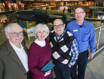 Luke Hendry/The Intelligencer Raymond Parent, second from right, stands with his brother-in-law, Pierre, left, sister Madeleine, and tour guide Mike Muzzerall above the Halifax bomber in the National Air Force Museum of Canada Thursday in Trenton. The siblings' father, Fernando, served on Halifaxes during the Second World War and it's long been Raymond's dream to see one.