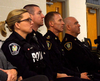 From left, Const. Tanya Calvert, Const Marc Roskamp, Chief Chris Herridge, and Insp. Hank Zehr sit at attention during a crowded community meeting about opioid abuse Thursday night. Their goal is to inform people about opioid addiction and abuse, so to limit overdoses in the area.