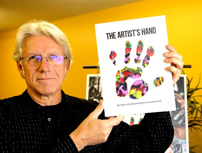 Sandy Singers, executive director of the Partners inn Mission Food Bank with the book, the Artist's Hand, which is a on sale to raise funds for the food bank in Kingston on Friday November 24 2017. Ian MacAlpine /The Whig-Standard/Postmedia Network