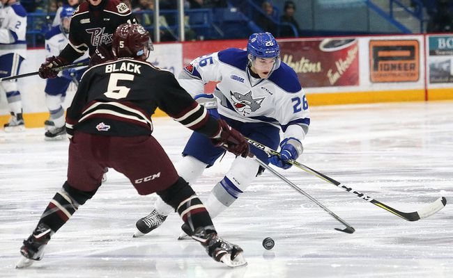Anthony Tabak, right, of the Sudbury Wolves, attempts to skate by Alex Black, of the Peterborough Petes, during OHL action at the Sudbury Community Arena in Sudbury, Ont. on Friday November 24, 2017. John Lappa/Sudbury Star/Postmedia Network