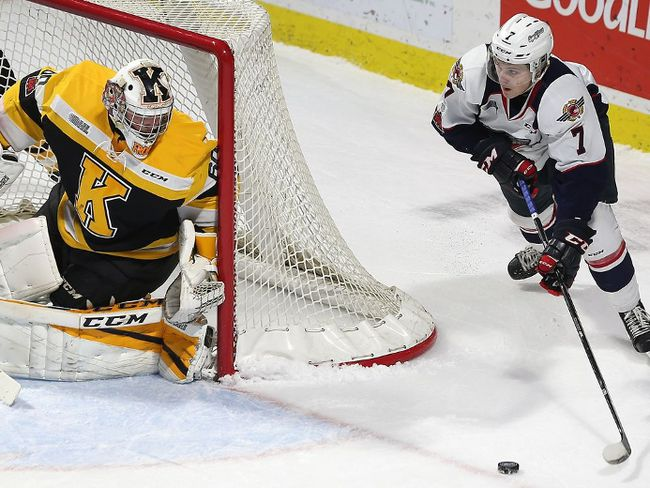 Tyler Angle of the Windsor Spitfires circles the net as Kingston Frontenacs goalie Jeremy Helvig hugs the post during their Ontario Hockey League game on Friday, Nov. 24, 2017, at the WFCU Centre in Windsor. (DAN JANISSE/Windsor Star/ Postmedia Network)
