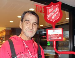 """John Moylan is doing his best to make sure everyone has a good Christmas. He's been volunteering to man the Salvation Army kettles for the past 10 or 15 years, to make sure """"Santa brings kids lots of good stuff for Christmas."""" The kettles are visible around the city until Christmas Eve. PJ Wilson/The Nugget"""