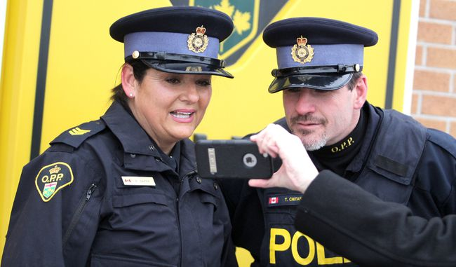 Sgt. Monique Baker and Const. Terry Chitaroni outside Sault Ste. Marie detachment of Ontario Provincial Police.