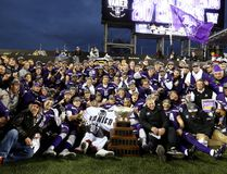 The Western Mustangs celebrate with the Vanier Cup at Tim Hortons Field in Hamilton, Ont. They defeated the Laval Rouge et Or 39-17. Mike Hensen/The London Free Press/Postmedia Network