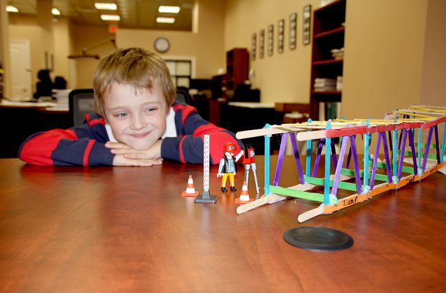 Five-year-old Liam Jahns of Chatham is shown with his popsicle stick truss bridge, which took second place at a recent engineering competition at the University of Windsor. (Trevor Terfloth/The Daily News)