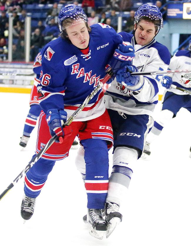 Darian Pilon of the Sudbury Wolves and Cole Carter of the Kitchener Rangers collide during OHL action against the Kitchener Rangers in Sudbury, Ont. on Sunday November 26, 2017. Gino Donato/Sudbury Star/Postmedia Network