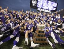 The Western Mustangs pose for a team photo with the Vanier Cup after defeating the Laval Rouge et Or in Hamilton on Saturday, Nov. 25, 2017. (Peter Power/The Canadian Press)