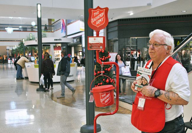 Bill Smith volunteers for the Salvation Army Chatham-Kent Ministries' Christmas Kettle Campaign at the Downtown Chatham Centre. The local Salvation Army says they are down in donations compared to last year.