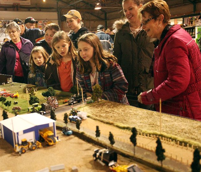 An interested group views a detailed miniature town at the Annual Collectable, Craft, Keepsake and Toy Show and Sale Nov. 25 at the Seaforth Agriplex. (Shaun Gregory/Huron Expositor)