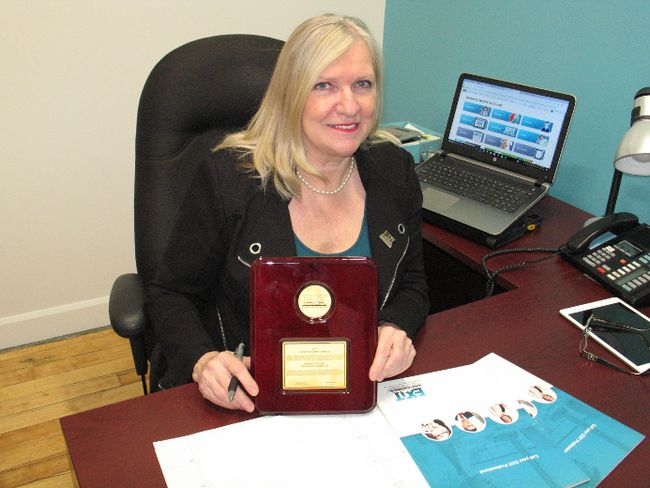 <p>Henrietta Duvall, broker of record/owner of EXIT Realty Seaway Brokerage, with the Esprit de Corps plaque for Canada, which she won recently at the EXIT convention in Dallas, Texas. Photo on Monday, November 27, 2017, in Cornwall, Ont. </p><p>
