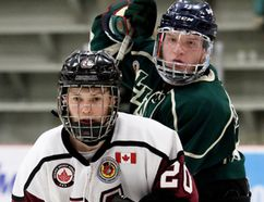 Chatham Maroons' Noah Labonte (20) battles with St. Marys Lincolns' Dylan Nafziger (25) in front of the Lincolns' net in the third period at Chatham Memorial Arena on Sunday, Nov. 26, 2017. (Mark Malone/The Daily News/Postmedia Network)