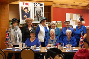 The group of ladies donned their best elegant attire and enjoyed wedding cake, coffee and tea, along with fun activities, including trivia about the royal couple. (PHOTO BY DAWN JOHNSTON/CLINTON NEWS RECORD)