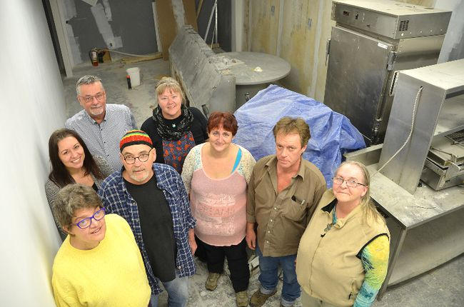The Canadian Mental Health Association Grey Bruce is in the process of renovating a space to add a commercial kitchen for the Fresh Roots Cafe and Catering social enterprise. Standing in the space, which is expected to be ready in the new year are, clockwise from front left, CMHA Grey Bruce members and employees Josee Costantini, April Robinson, Claude Anderson, Charles Coke, Teresa Pearson, Delia Burtwistle, Jeff Wise and Pat Reain on Tuesday, November 28, 2017 in Owen Sound, Ont. Rob Gowan/The Owen Sound Sun Times
