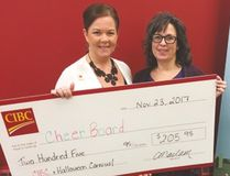 Deana Hendricks (right) recently accepted a Carman and District Cheer Board donation from CIBC's Catherine Maclam. The money and non-perishable food items were collected during this year's Halloween Carnival. For more information about the local Cheer Board or to contact the committee, call 204-745-6835 or find them on Facebook. (SUPPLIED PHOTO)