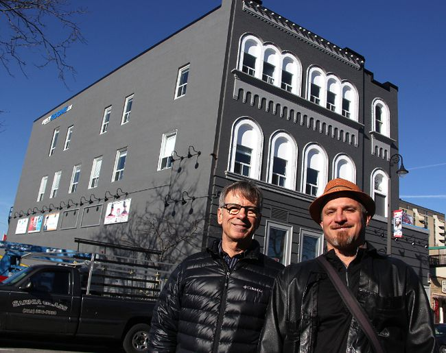 Jim Pumple and Patrick Coutu stand in front of 117 Christina St. N. which they're renovating into a short-term rental property. Longer-term rentals and a restaurant are queued to open on the lower two floors. (Tyler Kula/Sarnia Observer)