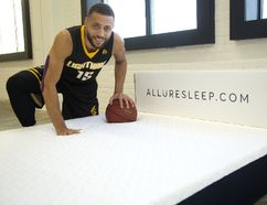 Garrett Williamson of the London Lightning and his brother Harley Williamson own Allure Sleep selling memory foam mattresses in London, Ont. Photograph taken on Tuesday November 28, 2017. (MIKE HENSEN, The London Free Press)