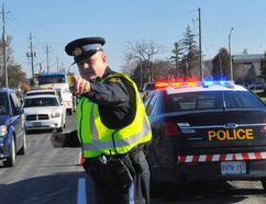 Norfolk OPP Const. Ed Sanchuk takes part in a RIDE check on Highway 3 West in Simcoe. Jacob Robinson/Simcoe Reformer