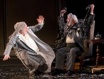 Ebenezer Scrooge, played by Benedict Campbell, is frightened by Jacob Marley (Patrick Monaghan) in A Christmas Carol at the Grand Theatre. (MIKE HENSEN, The London Free Press)