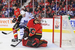 Mike Smith #41 of the Calgary Flames watches the shot of Nikita Zaitsev #22 (not pictured) of the Toronto Maple Leafs fly past him during an NHL game at Scotiabank Saddledome on November 28, 2017 in Calgary, Alberta, Canada. (Photo by Derek Leung/Getty Images)