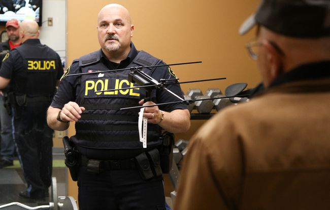 Tim Miller/The Intelligencer Constable Lonne Foeller holds up the hand-held receiver and watch used in a demonstration of Project Lifesaver at the Central Hastings OPP detachment on Wednesday in Madoc. Project Lifesaver allows police services to track down and locate residents who may wander due to dementia.