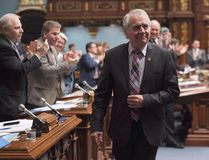 Parti Quebecois MNA Francois Gendron, walks back to his seat as members of the National Assembly applaud for being an elected member for the last 40 years in Quebec City on Tuesday, November 15, 2016. THE CANADIAN PRESS/Jacques Boissinot