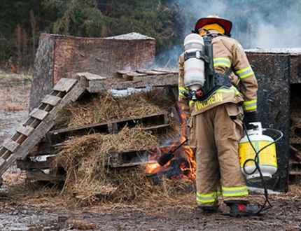 Quincy Emmons from FireRein prepares a burn for the demonstration of the ECO-GEL system on Nov. 16. (SUPPLIED PHOTOS/JIM PEETS)