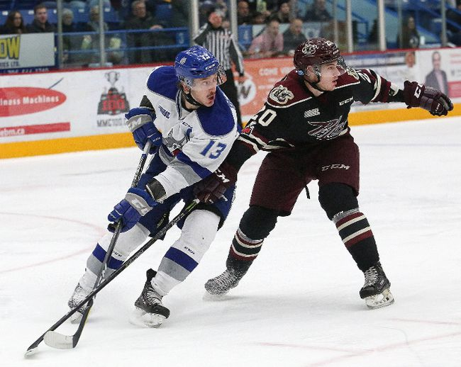 Michael Pezzetta, left, of the Sudbury Wolves, and Declan Chisholm, of the Peterborough Petes, battle for position during OHL action at the Sudbury Community Arena in Sudbury, Ont. on Friday November 24, 2017. John Lappa/Sudbury Star/Postmedia Network