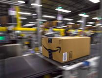Product moves along the conveyor inside the Amazon Fulfillment Centre in Brampton, Ont. on July 21, 2017. (Dave Abel/Toronto Sun/Postmedia Network)