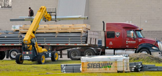 Parts of a pre-engineered building were unloaded last week at the corner of Gilbertson Drive and Davis Street East in Simcoe. Documents filed with Norfolk County say Park Road Automotive & Industrial Supply of Simcoe will build a 6,500-square-foot warehouse facility at this location.  MONTE SONNENBERG / SIMCOE REFORMER