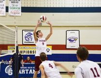 Cochrane Cobras Joseph Cline sets the ball in provincial play as the team took on the Titans in their first game at Strathmore on Nov. 23.