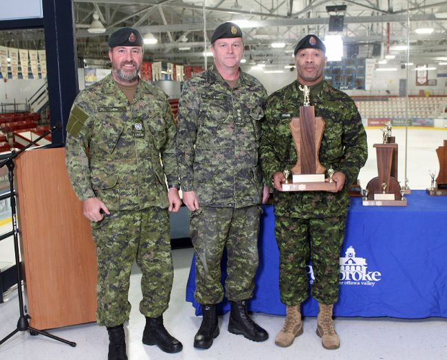 C�lina Ip / Daily Observer'Best Out of Town Float' was awarded to 'Transportation Company, 2 Service Battalion'. Pictured here (from left) are Master Warrant Officer Dave Issa, Capt. Dwight Sine and Warrant Officer Terrence Adams. Missing: Sergeant Will Grant.