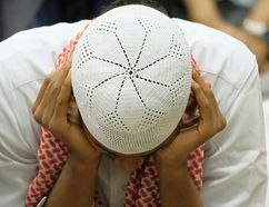 <p>A man prays during the Eid al-Adha prayer service at the Al Rashid Mosque in Edmonton, Alta., on Friday September 1, 2017. The Muslim holiday is celebrated by millions of people world-wide. </p><p> LARRY WONG/POSTMEDIA NETWORK