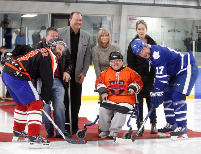 Former NHLer Wendel Clark  faced off against Lucas Horsman, the top local fundraiser, for the official puck during the all-star game at the North Bay Celebrity Hockey Classic at Pete Palangio Arena. Dropping the puck was local ambassador Dylan Rivenbark, who was joined by his mother, Mayor Al McDonald and Easter Seals representatives.
