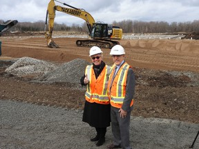 Wayne Lowrie/The Recorder and Times Westport Mayor Robin Jones gives the thumbs up with Infrastructure minister Bob Chiarelli in front of the sewage project.