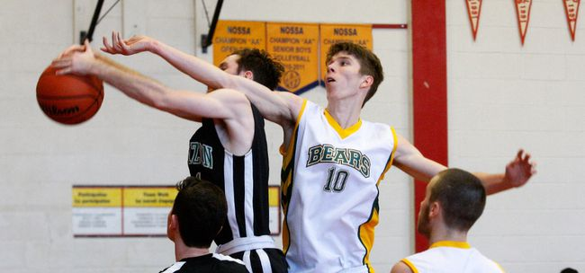 Nathan Dufresne (10) of the St. Joseph-Scollard Hall Bears goes up for a rebound against Horizon during the NDA team's first game in the 60th Art Gabor Classic Basketball Tournament on the Chippewa Secondary hardcourt, Friday. Dufresne contributed 17 points to the Bears' 64-30 win. Dave Dale / The Nugget