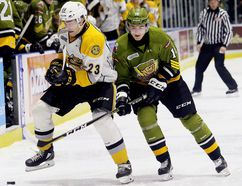 Sarnia Sting's Curtis Egert (23) and North Bay Battalion's Kurtis Evans (14) battle for the puck in the first period at Progressive Auto Sales Arena in Sarnia, Ont., on Friday, Dec. 1, 2017. (Mark Malone/Postmedia Network)