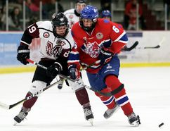 Chatham Maroons' Steven Fowler (89) and Strathroy Rockets' Liam Israels (6) battle for the puck in the third period at Chatham Memorial Arena on Sunday, Dec. 3, 2017. (Mark Malone/Chatham Daily News/Postmedia Network)
