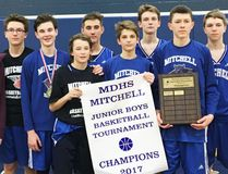 Members of the Mitchell DHS junior boys basketball team captured the championship of their own tournament this past Saturday, Dec. 2. SUBMITTED