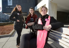 Julie Baumann, of SafeSpace, AnnaLise Trudel, of Anova, and Jodi Hall, of Fanshawe College, l-r, at London's City Hall where they are pushing to remove the no touch rule from the bylaws governing strips clubs and body rub parlours. (MORRIS LAMONT/THE LONDON FREE PRESS)
