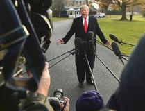 President Donald Trump speaks to reporters on the South Lawn of the White House in Washington, Monday, Dec. 4, 2017. (AP Photo/Susan Walsh)