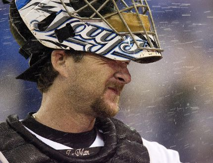 Toronto Blue Jays catcher Gregg Zaun is sprayed with water by teammates while waiting to do an interview after the Blue Jays defeated the Los Angeles Dodgers 12-1 on June 6, 2007. (Greg Henkenhaf/Toronto Sun/Postmedia Network)
