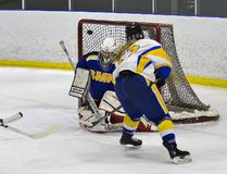 BCI's Emily Rickwood takes a shot on the St. Maximilian Kolbe goalie during a high school hockey tournament at the Wayne Gretzky Sports Centre. (Brian Thompson/The Expositor)