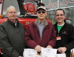 A secret Santa serving the Delhi area for years finally stepped forward on the weekend. He's Bruce Martin, 89, of Delhi, at centre. In collaboration with Matt Wilkinson, right, owner of Wilkinson's Your Independent Grocer, Martin has donated tens of thousands of dollars over the years to the Sharing Pantry food bank in Delhi. At left is food bank representative Andy Fitch, who received another $1,000 cheque from Martin on Saturday. MONTE SONNENBERG / SIMCOE REFORMER