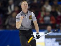 Skip Brad Jacobs pumps his fist after throwing his final stone in the fifth end during Olympic curling trials Tuesday in Ottawa against Team Laycock. Adrian Wyld/Canadian Press
