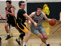 Frontenac Falcons Connor Vreeken drives to the net past LaSalle Black Knights Landon Elliot, left, and Hughsten Coleman during senior boys basketball action at LaSalle Secondary School in Kingston on Tuesday December 5 2017. Ian MacAlpine /The Whig-Standard/Postmedia Network