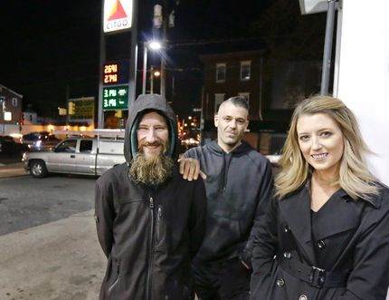 In this Nov. 17, 2017, photo, Johnny Bobbitt Jr., left, Kate McClure, right, and McClure's boyfriend Mark D'Amico pose at a Citgo station in Philadelphia. When McClure ran out of gas, Bobbitt, who is homeless, gave his last $20 to buy gas for her. McClure started a Gofundme.com campaign for Bobbitt that has raised more than $275,000. (Elizabeth Robertson/The Philadelphia Inquirer via AP, File
