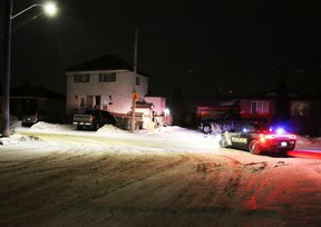 Scene at 524 Spruce Street South around 5:20 Wednesday morning after a Dodge Ram pickup truck hit the side of a house. LEN GILLIS / Postmedia Network